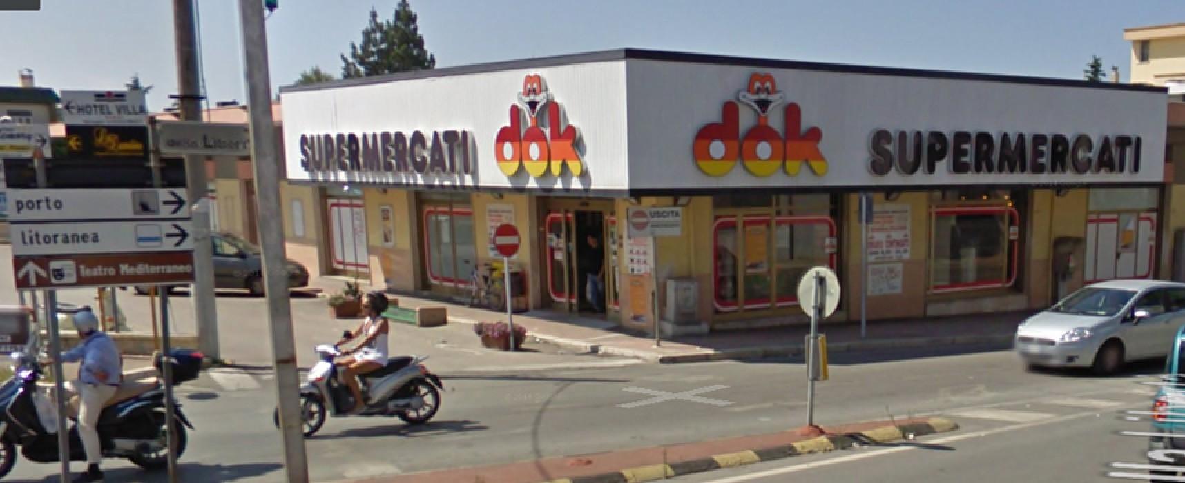 Rapina alla Dok in via della Libertà, il ladro è fuggito in bicicletta dopo il colpo